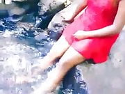 Sexy girl playing water in a river