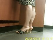 Sexy Asian Mature with pretty feet wearing wooden clogs