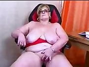 Busty mature British housewife Julia playing with her pussy