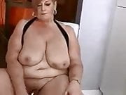 Busty mature British housewife Julia dildos her fat pussy