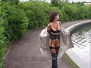Sexy Brunette in Kinky Boots & Stockings Walks Along Canal